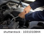 a man holding wench for repair... | Shutterstock . vector #1031010844