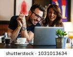 young couple sitting at the... | Shutterstock . vector #1031013634