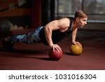 athlete in the gym is squeezed... | Shutterstock . vector #1031016304