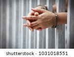Close Up Of Prisoner Hands In...