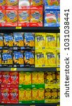Small photo of Koh Lipe, Thailand - January 16, 2018 - rows of shelves with variety of kid food or biscuit stick like Pocky in a Grocery market, Convenience Store.