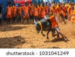 Small photo of AVANYABURAM,INDIA- January 14, 2018 : Competitors taking part in the bull taming sport of jallikattu on January 14, 2018 in AVANYABURAM ,Tamil Nadu, India.Union Government grant permission 2017