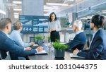 beautiful businesswoman gives... | Shutterstock . vector #1031044375