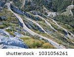u turns   telephoto  shot of... | Shutterstock . vector #1031056261