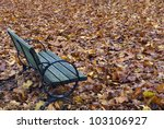 autumn bench surrounded by... | Shutterstock . vector #103106927