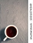 strong black tea in white cup... | Shutterstock . vector #1031074549