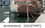 hull of the old ship moored to... | Shutterstock . vector #1031074951