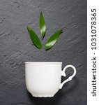 detox tea concept  white cup on ... | Shutterstock . vector #1031078365