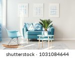 palm on light blue  round table ... | Shutterstock . vector #1031084644