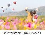 tourist asian woman relax and... | Shutterstock . vector #1031092351