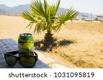 sunglasses with a drink is... | Shutterstock . vector #1031095819