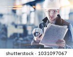 factory engineer checks the... | Shutterstock . vector #1031097067