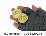Small photo of hand of poor man with two golden bitcoin