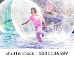 Young Girl Playing Inside A...