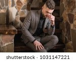 handsome young elegant man pose ... | Shutterstock . vector #1031147221