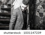 handsome young elegant man pose ... | Shutterstock . vector #1031147239