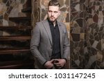 handsome young elegant man pose ... | Shutterstock . vector #1031147245