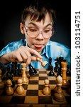 wunderkind play chess. Nerd boy. - stock photo
