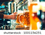 hand of bartender pouring a... | Shutterstock . vector #1031156251