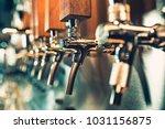 the beer taps in a pub. nobody. ... | Shutterstock . vector #1031156875
