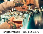 hand of bartender pouring a... | Shutterstock . vector #1031157379