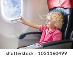 child in airplane. kid in air... | Shutterstock . vector #1031160499