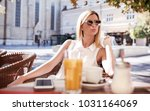 beautiful lonely woman sitting... | Shutterstock . vector #1031164069