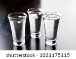 three vodka shots with ice on... | Shutterstock . vector #1031175115
