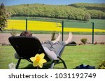 woman relaxing on a sun lounger ... | Shutterstock . vector #1031192749