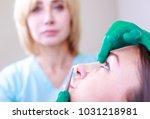 cosmetic surgeon examining... | Shutterstock . vector #1031218981