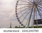 ferris wheel in paris | Shutterstock . vector #1031243785