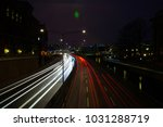 night city car light trails. | Shutterstock . vector #1031288719