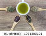 cup of green tea and four... | Shutterstock . vector #1031303101
