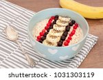 oatmeal bowl with fruits and... | Shutterstock . vector #1031303119