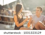 romantic couple drinking wine... | Shutterstock . vector #1031323129