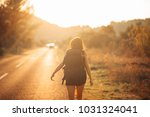 young backpacking adventurous... | Shutterstock . vector #1031324041
