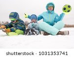 a young lady in a blue ski suit ... | Shutterstock . vector #1031353741