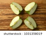 top view of apple slices placed ... | Shutterstock . vector #1031358019