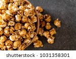 popcorn with caramel in bowl | Shutterstock . vector #1031358301