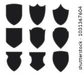 black shield icons set on white ... | Shutterstock .eps vector #1031367604