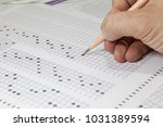 students hand doing exams quiz... | Shutterstock . vector #1031389594