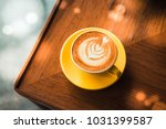 flat white coffee in yellow cup ...   Shutterstock . vector #1031399587