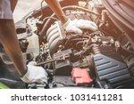 repairman working in garage.... | Shutterstock . vector #1031411281