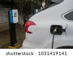 electric cars are charging in... | Shutterstock . vector #1031419141