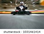 the man is going on the go kart ... | Shutterstock . vector #1031461414