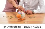 beautiful couple saving money...   Shutterstock . vector #1031471311