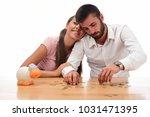 beautiful couple saving money...   Shutterstock . vector #1031471395