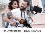 happy couple on scooter making... | Shutterstock . vector #1031486401