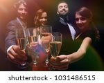 cheerful people celebrating a... | Shutterstock . vector #1031486515