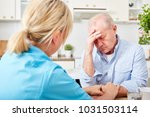 nurse comforts senior man with... | Shutterstock . vector #1031503114